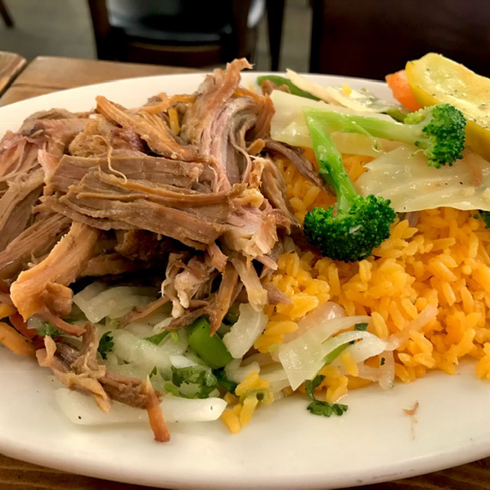 Roast pork, yellow rice and vegetables
